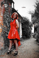 Red PVC dress with black lace trim
