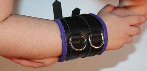 Wide cuff arm binder and bondage belt