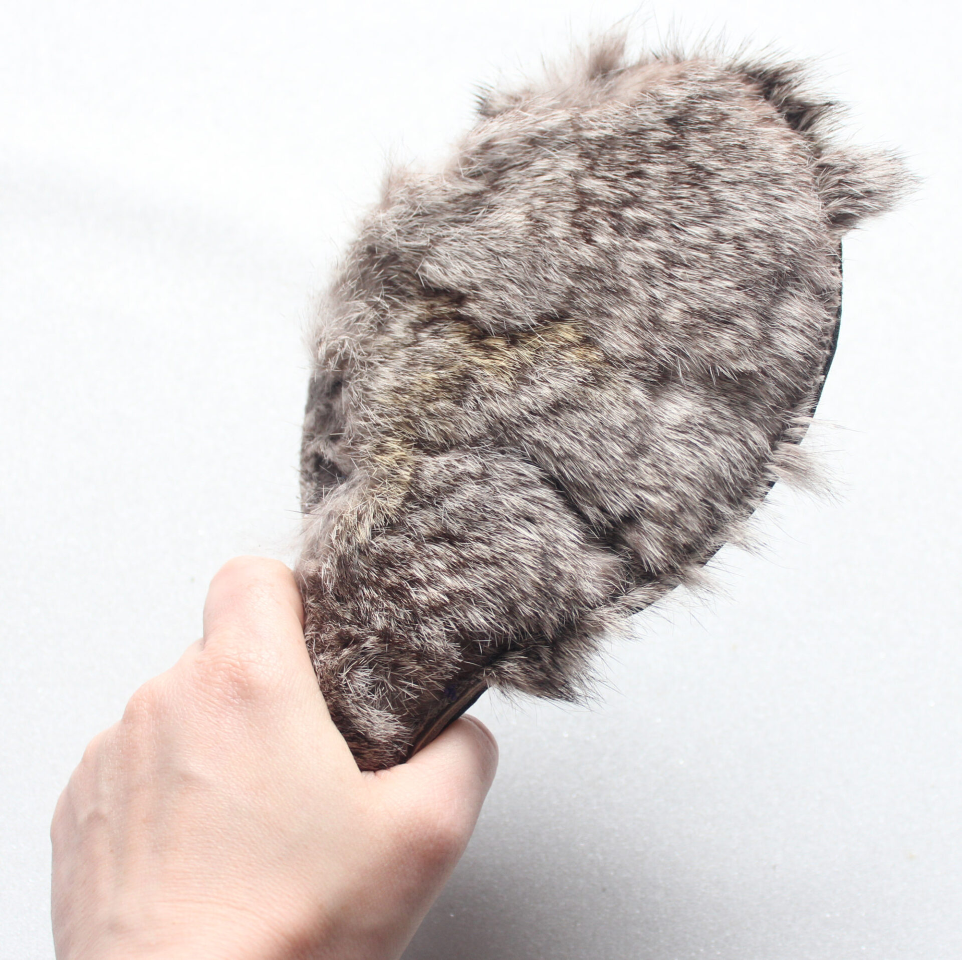 Fur and leather circle paddle